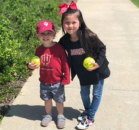 Picture of a kids from IU Women's Softball game.